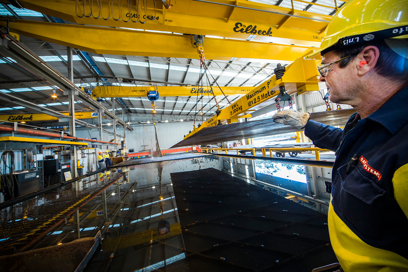 <p>Cutting steel using Australia's largest plasma cutter at BAE Systems' Henderson shipyard.</p>