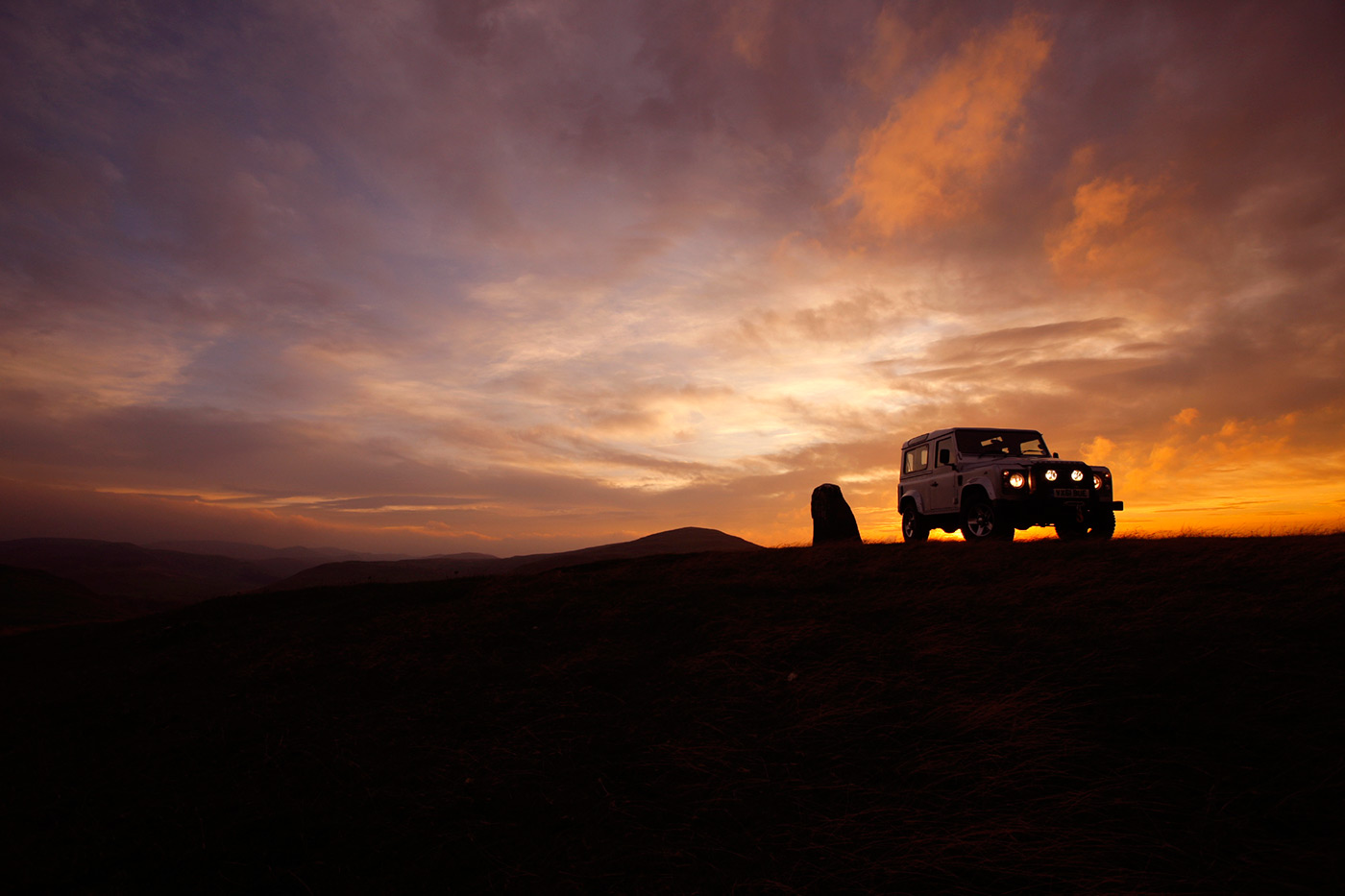 <p>The iconic silhouette of the Land Rover Defender in the Scottish borders.</p>