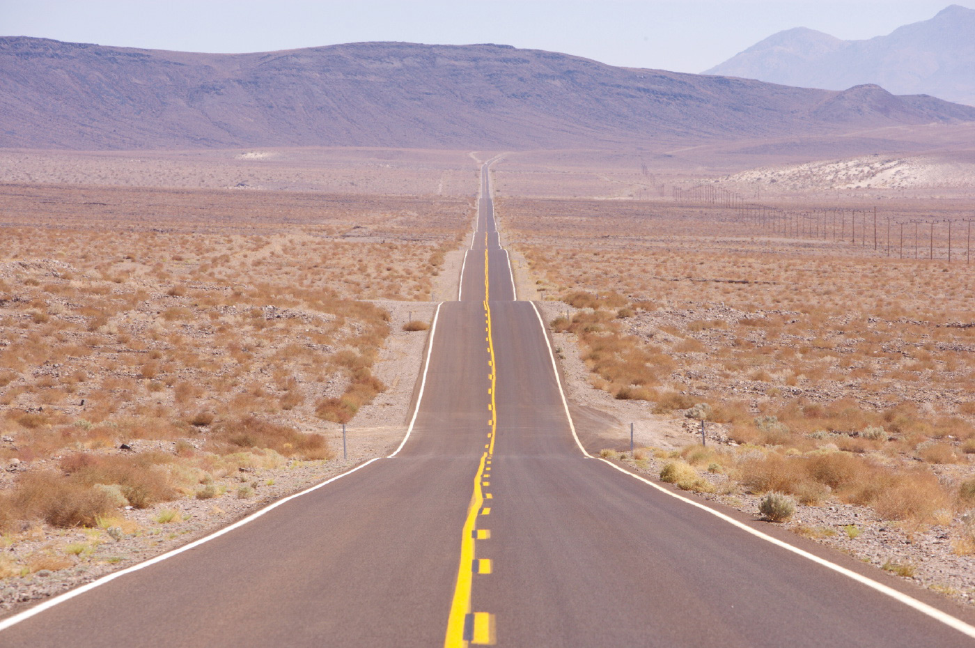 <p>Long straight road heading into Death Valley, USA.</p>