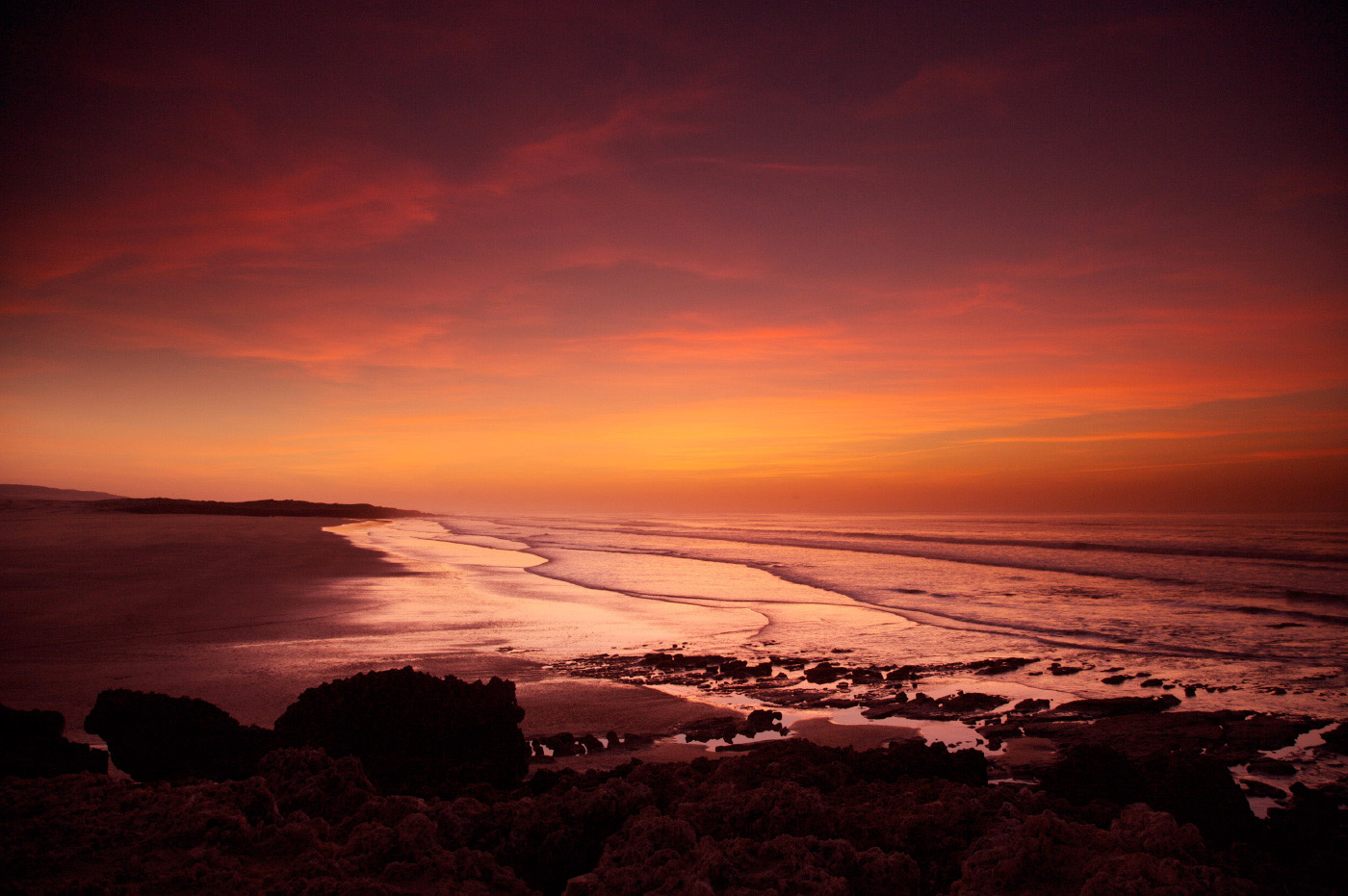 <p>Stunning sunset at an empty beach on the West coast of Morocco.</p>