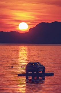 <p>Sunset on the Montenegrin coast - a floating Jaguar F-PACE in the foreground.</p>
